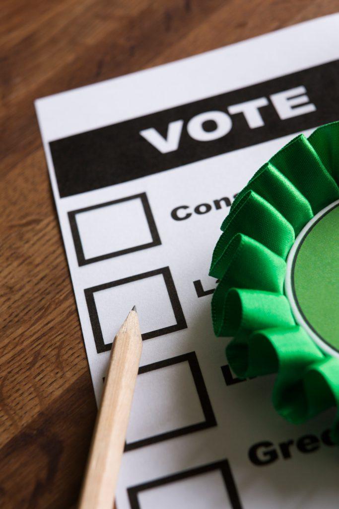 Green Political Rossette On Ballot Paper For Election